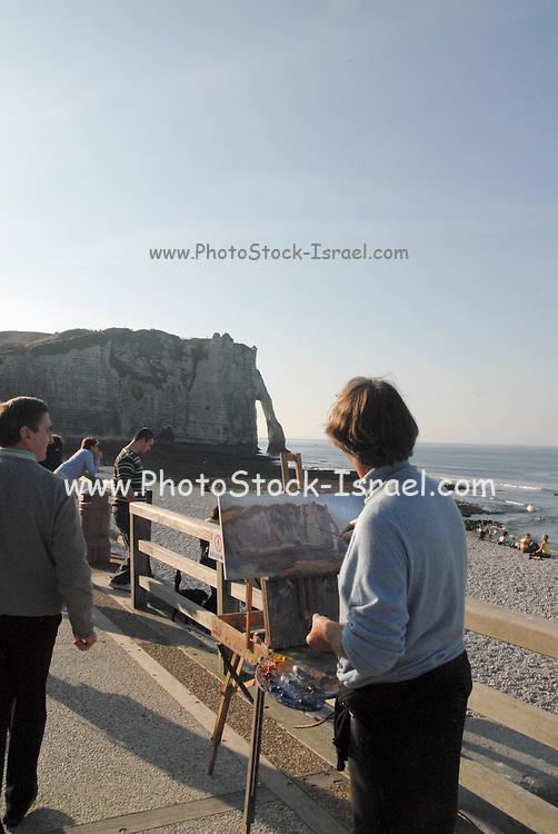 France, Normandy, Coast, Etretat, Porte d'Aval Arch painter paints the arch