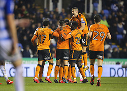 Wolves Conor Coady jumps on Matt Doherty after scoring his side's second goal of the game during the Sky Bet Championship match at the Madejski Stadium, Reading.