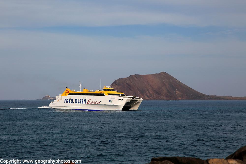 Fred Olsen Express ferry ship passing Los Lobos island, Corralejo, Fuerteventura, Canary Islands, Spain