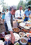"""Democratic presidential nominee Jimmy Carter and VP nominee Walter """"Fritz"""" Mondale have a picnic lunch on the grounds after a Sunday service at the Plains, GA Baptist Church."""