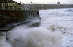 Waves crashing against sea defences in a storm; Whitley Bay; Tyneside; north east England UK