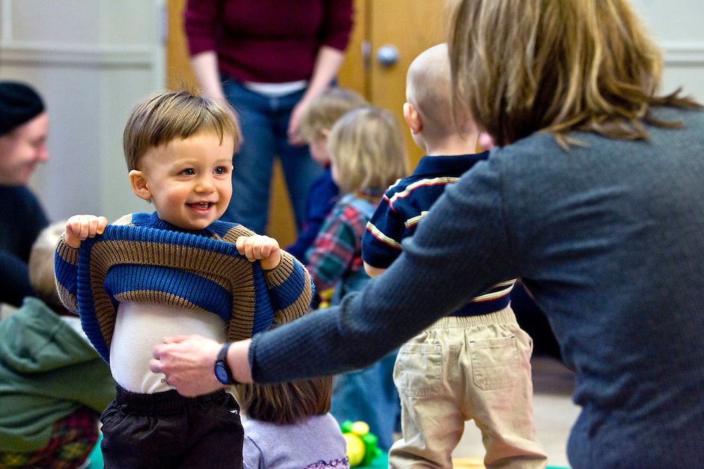"""LITCHFIELD, CT - 27 JANUARY 2009 -012709JT08-.FOR COUNTRY LIFE: Thatcher Wood, 13-months-old, plays with his grandmother Linda Timman during the """"Bouncing Babies"""" reading program at Oliver Wolcott Library in Litchfield on Tuesday, Jan. 27. The program, which is open to children from 0-24 months, is every Tuesday beginning at 10:30 a.m. and consists of 20 minutes of story time followed by 15 minutes of play time. .Josalee Thrift / Republican-American"""