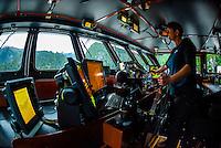 On the bridge of the Wilderness Explorer (small cruise ship), Inside Passage, Southeast Alaska USA.