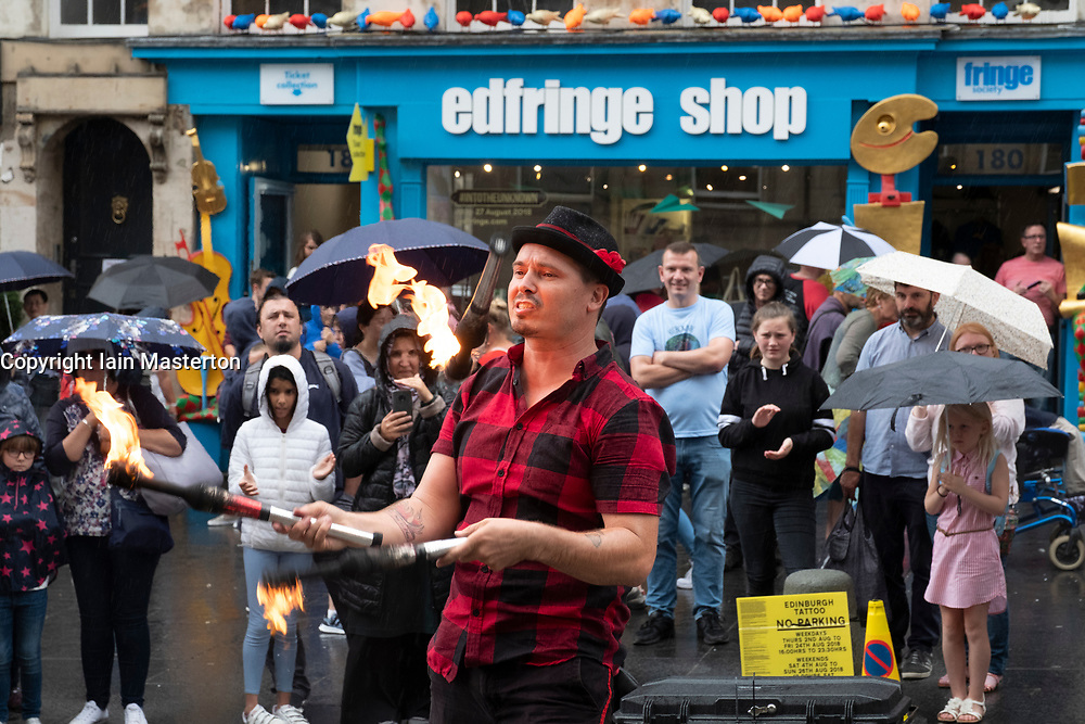 Edinburgh, Scotland, UK; 2 August, 2018. On day before official opening of the Edinburgh Festival Fringe 2018, performers are active on the Royal Mile including this fire eater.