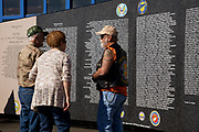 Visiitors interacting with traveling Vietnam War Memorial at Warbirds Over the West.