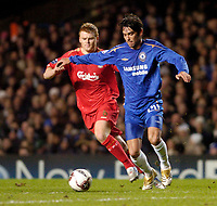 Photo: Leigh Quinnell.<br /> Chelsea v Liverpool. UEFA Champions League. <br /> 06/12/2005. Chelseas Paulo Ferreira battles with Liverpools  John Arne Riise.