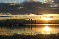 The view from Williamstown as the the sunrises across the bay over Melbourne on the 7th day the state wide COVID-19 lockdown that has been placed on the State of Victoria. (Photo by Michael Currie/Speed Media)
