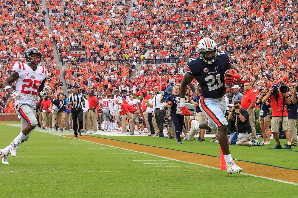 Auburn Tigers running back Kerryon Johnson (21) carries the ball for a touchdown during an NCAA football game against the Mississippi Rebels, Saturday, October 7, 2017, in Auburn, AL. Auburn won 44-23. (Paul Abell via Abell Images for Chick-fil-A Peach Bowl)