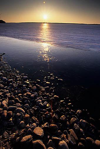 Minnesota, Sunset over shoreline of Gull Lake in central Minnesota.