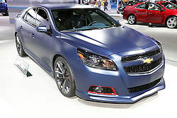 08  February 2013: 2013 Chevrolet Malibu Performance Concept car. Chicago Auto Show, Chicago Automobile Trade Association (CATA), McCormick Place, Chicago Illinois<br /> <br /> 2013 CHEVROLET MALIBU: Chicago area consumers were among the first to see the all-new 2013 Chevrolet Malibu midsize sedan displayed at last year's Chicago Auto Show. Back for a return engagement, the '13 Malibu continues as the auto industry's longest-running midsize nameplate, spanning 36 years and eight generations. The 2013 Malibu wears fresh exterior styling that carries DNA from its sibling vehicles, the Camaro and Corvette. With a wide, athletic stance the Malibu is offered in LS, LT and LTZ trim levels, with 10 exterior and four interior color combination choices. Dual-cockpit, five-passenger interior provides nearly four cubic feet of additional interior volume, along with more shoulder and hip room, more quietness, more premium materials and content, and greater craftsmanship compared to the previous model. A 2.5-liter four-cylinder engine comes with the next-generation Hydra-Matic six-speed automatic transmission, and is rated at 190 horsepower with 180 lb. ft. of torque to the front-wheels. Examples of high tech items available include Chevrolet MyLink in-car infotainment system that integrates online services like Pandora Internet radio and Stitcher SmartRadio. Tailored trunk can carry 16.3 cu. ft. of groceries or luggage.