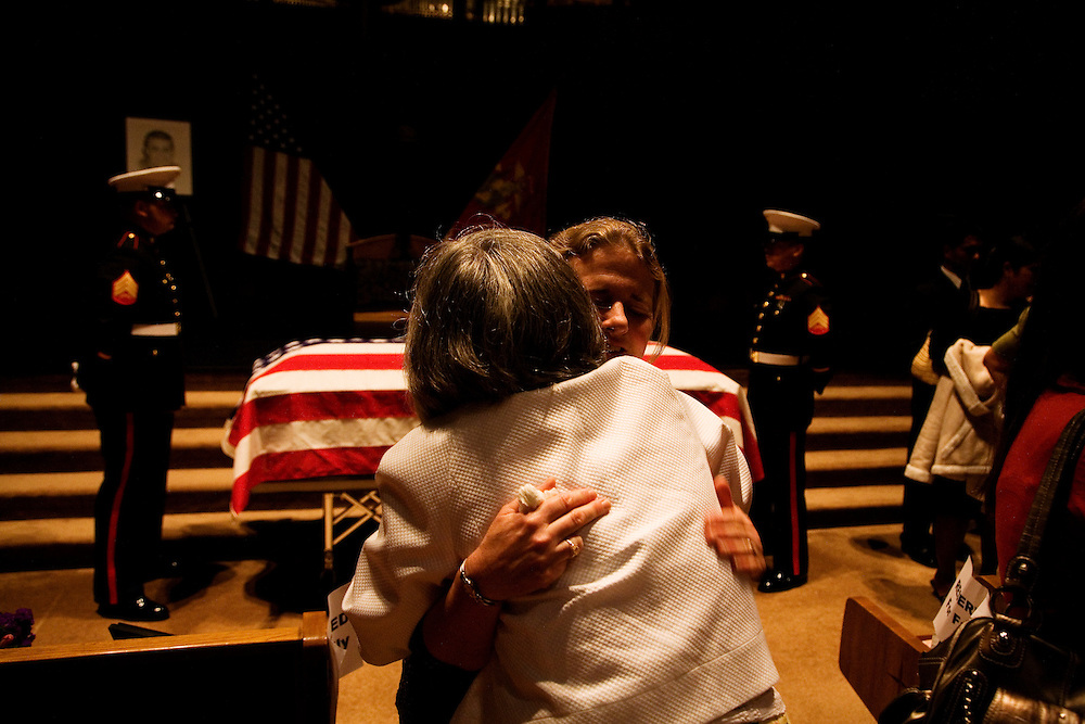 Jenny Madrazo, mother of Lt. Madrazo, embraces a family member after the service...Service (Funeral) for Lt. Nicolas Madrazo of Bothell, Washington. Killed in Action September 9, 2008 in Afghanistan...Westminster Chapel, Bellevue, Washington.