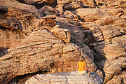 A visitor (MR) enjoys the Calico Hills in Red Rock Canyon, Las Vegas, Nevada. (model released)