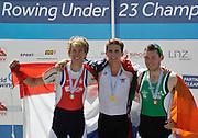 Linz. AUSTRIA.   Sunday A Finals, Men's Lightweight  Single Sculls left, medalist, Bronze, NED BLM1X, Franciscus GOUTIER. Centre. Gold medalist USA USA BLM1X Andrew CAMPBELL and Right Bronze medalist, IRL BLM1X. Paul O'DONOVAN FISA U23 World Championships, Linz-Ottensheim Rowing Course.  10:55:41 Sunday  28/07/2013. [Mandatory Credit, Peter Spurrier/ Intersport Images] ,