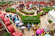Visitors walk through the Alice in Wonderland maze at Walt Disney Co.s Shanghai Disneyland theme park  towards the iconic castle during a trial run ahead of its official opening, in Shanghai, China, on Wednesday, June 8, 2016. The $5.5 billion Shanghai Disneyland is one  of the most profitable Disney ventures in the world and the first theme park on mainland China.