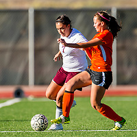 092613       Brian Leddy<br /> Gallup Bengal Tara Soland (4) and Rehoboth Lynx Celine Bia (8) struggle for the ball during Thursday's game at Rehoboth.