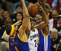June 9, 2017 - Cleveland, OH, USA - The Cleveland Cavaliers' Richard Jefferson, middle, passes the ball out while being double-teamed by the Golden State Warriors' JaVale McGee and Kevin Durant during the first quarter during Game 4 of the NBA Finals at Quicken Loans Arena in Cleveland on Friday, June 9, 2017. (Credit Image: © Leah Klafczynski/TNS via ZUMA Wire)