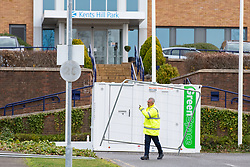 © Licensed to London News Pictures. 08/02/2020. Milton Keynes, UK. A contractor moves perimeter fencing into place at the entrance to the Kents Hill Park Training and Conference Centre. A Milton Keynes conference centre is to house evacuees from the Chinese city of Wuhan, the epicentre of the Novel Coronavirus (2019-nCoV) outbreak, the British citizens are due to be flown back on Sunday 9th February and are expected to land at RAF Brize Norton in Oxfordshire and will remain at the conference centre for 14 days to be monitored. Photo credit: Peter Manning/LNP