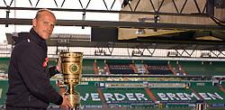 """05.05.2010, Weser Stadion, Bremen, GER, Interview Thomas Schaaf (Trainer / Coach Werder Bremen), er praesentiert den Pokal im Stadtion. Auf den Sitzelementen im Hintergrund auf der gegenueber liegenden Tribuehne, steht """"Werder Bremen"""". Foto © nph / Arend.Auf Anfrage in hoeherer Qualitaet/Aufloesung / SPORTIDA PHOTO AGENCY"""