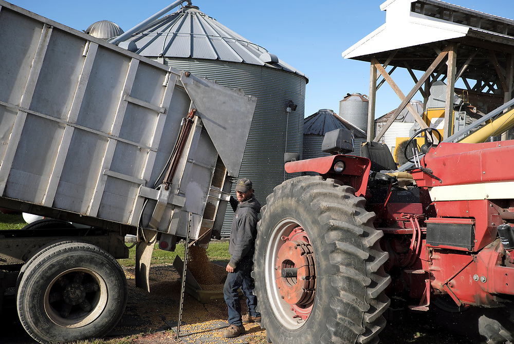 Mark Heitzman works on loading corn into a grain silo Oct. 25, 2018, on the Brewer family farm in Bangor, Pennsylvania. Recent retaliatory tariffs implemented by China on grain exports, including soybeans which are the top agricultural export in the United States, are hurting farmers in Pennsylvania. (Photo by Matt Smith)