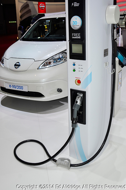 GENEVA, SWITZERLAND - MARCH 4, 2014: Nissan e-NV200 and charging station on display during the Geneva Motor Show.
