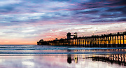 Surfing At Oceanside Pier During Sunset