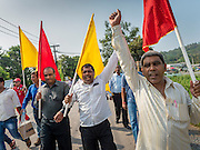 20 SEPTEMBER 2015 - SARIKA, NAKHON NAYOK, THAILAND: Men praise Ganesha while they walk to the river for the culmination of the Ganesh festival at Shri Utthayan Ganesha Temple in Sarika, Nakhon Nayok. Ganesh Chaturthi, also known as Vinayaka Chaturthi, is a Hindu festival dedicated to Lord Ganesh. Ganesh is the patron of arts and sciences, the deity of intellect and wisdom -- identified by his elephant head. The holiday is celebrated for 10 days. Wat Utthaya Ganesh in Nakhon Nayok province, is a Buddhist temple that venerates Ganesh, who is popular with Thai Buddhists. The temple draws both Buddhists and Hindus and celebrates the Ganesh holiday a week ahead of most other places.    PHOTO BY JACK KURTZ
