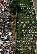 A cemetery and auto junkyard separated by a fence along Stockton Blvd. Sacramento, California