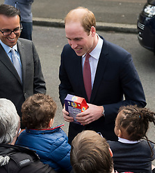 © London News Pictures. 27/03/2015. Prince William being given an easter egg by a member of the public as he and and a heavily pregnant Catherine, Duchess of Cambridge leave following a visit at youth charity XLP (The eXceL Project) at Christ Church in Gipsy Hill, south London on March 27, 2015. Photo credit: Ben Cawthra/LNP