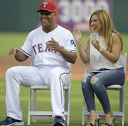 September 8, 2017 - Arlington, TX, USA - Texas Rangers third baseman Adrian Beltre and his wife, Sandra Beltre, share a laugh during the celebration of his reaching the 3,000-hit plateau earlier this season, before a game against the New York Yankees at Globe Life Park in Arlington, Texas, on Friday, Sept. 8, 2017. (Credit Image: © Max Faulkner/TNS via ZUMA Wire)