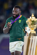 Tendai Mtawarira of South Africa looks at the medal after the Rugby World Cup  final match between England and South Africa at the International Stadium ,  Saturday, Nov. 2, 2019, in Yokohama, Japan. South Africa defeated England 32-12. (Florencia Tan Jun/ESPA-Image of Sport)