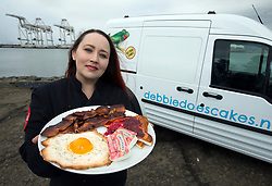 Debbie Goard, founder of Debbie Does Cakes in Oakland, Calif., poses for a photograph by her delivery van with one of her edible creations, Tuesday, April 11, 2017 in Alameda, Calif. (Photo by D. Ross Cameron)