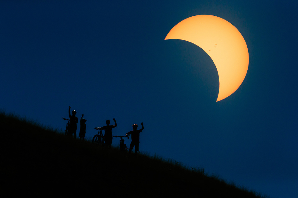 L - R Heather Goodrich, Micah Goodrich, Courtney Gauthier, and Andrew Whiteford Metallica up for the photographer during the 2017 Total Eclipse across the United States.