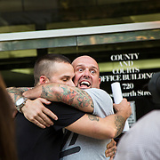 Joey Hewell (left) & Scott Lindsley embrace shortly after a federal judge in Asheville struck down the states gay marriage ban.