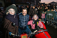 BONDENO, ITALY - 6 JANUARY 2020: Matteo Salvini, former Interior Minister of Italy and leader of the far-right League party, poses for a pictures with two Befanas in Bondeno, Italy, on January 6th 2020.<br /> <br /> In Italian folklore, Befana is an old woman who delivers gifts to children throughout Italy on Epiphany Eve (the night of January 5) in a similar way to St Nicholas or Santa Claus.<br /> <br /> Matteo Salvini is campaigning in the region of Emilia Romagna to support the League candidate Lucia Borgonzoni running for governor.<br /> <br /> After being ousted from government in September 2019, Matteo Salvini has made it a priority to campaign in all the Italian regions undergoing regional elections to demonstrate that, in power or not, he still commands considerable support.<br /> <br /> The January 26th regional elections in Emilia Romagna, traditionally the home of the Italian left, has been targeted by Matteo Salvini as a catalyst for bringing down the government. A loss for the center-left Democratic Party (PD) against Mr Salvini's right would strip the centre-left party of control of its symbolic heartland, and probably trigger a crisis in its coalition with the Five Star Movement.