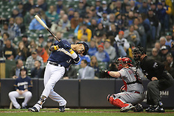 April 18, 2018 - Milwaukee, WI, U.S. - MILWAUKEE, WI - APRIL 18: Milwaukee Brewers shortstop Orlando Arcia (3) spins away from a pitch during a baseball game between the Milwaukee Brewers and the Cincinnati Reds at Miller Park on April 18, 2018 in Milwaukee, WI. (Photo by Larry Radloff/Icon Sportswire) (Credit Image: © Larry Radloff/Icon SMI via ZUMA Press)
