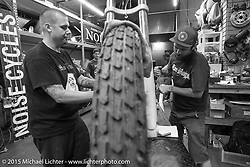 Adam Munz and Brandon Casquilho do final prep on Brandon's bike at Noise Cycles the night before Born Free 6. Santa Ana, CA. USA. June 26, 2014.  Photography ©2014 Michael Lichter.