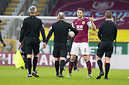 Burnley defender James Tarkowski (5) has a word with referee Jonathan Moss during the FA Cup match between Burnley and Milton Keynes Dons at Turf Moor, Burnley, England on 9 January 2021.