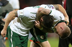 Republic of Ireland's James McClean and Republic of Ireland's Robbie Brady celebrate after the final whistle of the 2018 FIFA World Cup Qualifying Group D match at the Cardiff City Stadium, Cardiff. PRESS ASSOCIATION Photo. Picture date: Monday October 9, 2017. See PA story SOCCER Wales. Photo credit should read: Nigel French/PA Wire. RESTRICTIONS: Editorial use only, No commercial use without prior permission.