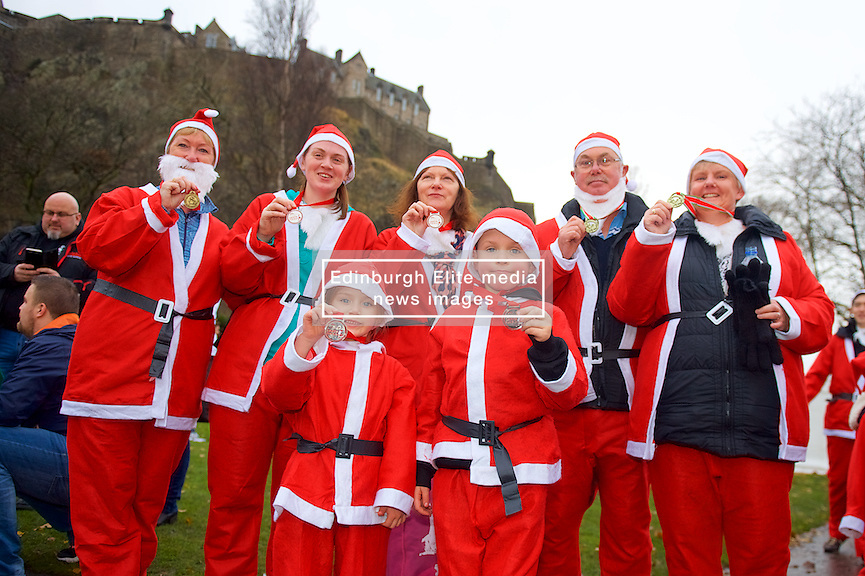 The Sincere family proudly showing their medals after taking part in Scotland's fundraising Santa's run, walk and stroll around Edinburgh's West Prices Street Gardens, raising money to grant the Wishes of Children for When You Wish Upon A Star. Sunday 11th December 2016. (c) Brian Anderson | Edinburgh Elite media