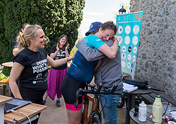 © Licensed to London News Pictures; 27/05/2021; Bristol, UK. KATE STRONG finishes her attempt for 3 world records for static cycling, applauded by her support team and setting 3 world records, a world record first for the furthest distance cycled on a static bike in 24 hours by a female, and beating the female 1-hour and 12-hour world records during the same 24 hours. Kate cycled 433.1 miles in 24 hours, beating her target of 430 miles. The world record attempt took place on 26-27 May 2021 at The Observatory in Clifton, Bristol, starting at 3pm on Wednesday and finishing at 3pm on Thursday. Guinness set the minimum target for 24 hours at 680km (422.53 miles) for it to be recognised as a World Record. Photo credit: Simon Chapman/LNP.