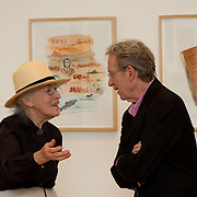 William Wegman with a gallery visitor.
