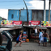 Youths play basketball in the streets of the Parola district of Tondo, Manila, the Philippines, one of the worst slum areas of Manila on October 8, 2008 in Manila, the Philippines. Photo Tim Clayton