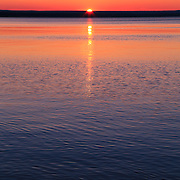 """""""Long Sunset""""<br /> <br /> Beautiful hued sunset and reflections in portrait style!!<br /> <br /> Sunset Images by Rachel Cohen"""
