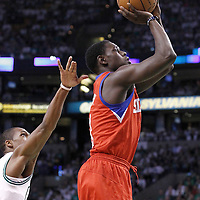 26 May 2012: Philadelphia Sixers point guard Jrue Holiday (11) takes a jumpshot during the Boston Celtics 85-75 victory over the Philadelphia Sixer, in Game 7 of the Eastern Conference semifinals playoff series, at the TD Banknorth Garden, Boston, Massachusetts, USA.