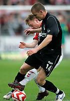 Fotball , 27. mai 2007 , OB's målscorer Esben Hansen kæmper med AaB's Fredrik Winsnes i kampen om turneringens tredjeplads i sidste runde af SAS Ligaen mellem Aab og OB på Aalborg Stadion, søndag. Aalborg - Odense<br /> Norway only