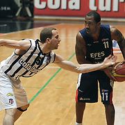Besiktas's Muratcan GULER (L) and Efes Pilsen's Bootsy THORNTON (R) during their Turkish Basketball league Play Off semi final second leg match Besiktas between Efes Pilsen at the BJK Akatlar Arena in Istanbul Turkey on Wednesday 12 May 2010. Photo by Aykut AKICI/TURKPIX