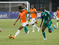 Photo: Steve Bond/Richard Lane Photography.<br />Nigeria v Ivory Coast. Africa Cup of Nations. 21/01/2008. Didier Drogba (L) lines up to shoot. George Olofinjana (R) tries to close him down
