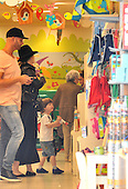 Adele toy store with son