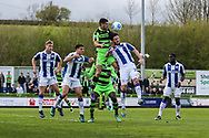 Forest Green Rovers Omar Bugiel(11) jumps to head the ball during the Vanarama National League match between Forest Green Rovers and Chester FC at the New Lawn, Forest Green, United Kingdom on 14 April 2017. Photo by Shane Healey.