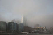 Thick fog over London obscures The Shard which is under construction at London Bridge making a peaceful yet eerie landscape atmosphere as towers appear and disappear. Modern commercial architecture is releaved through a mist. Construction of London's latest planned skyscraper, the Shard (aka The Shard of Glass). It is being built on the south side of the city near London Bridge. Shard London Bridge, previously known as London Bridge Tower, and also known as the Shard of Glass. The Shard is a supertall skyscraper under construction in Southwark. When completed in 2012 it will be the tallest building in Europe. The tower will stand at 310 m (1,017 ft) tall and have 72 floors, plus 15 further floors in the roof. Renzo Piano, the building's architect, worked together with architectural firm Broadway Malyan during the planning stage of the project.